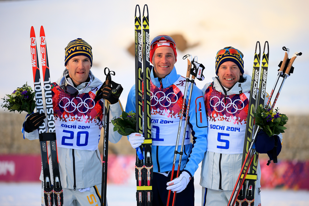 . (L-R) Silver medalist Teodor Peterson of Sweden, gold medalist Ola Vigen Hattestad of Norway and bronze medalist Emil Joensson of Sweden celebrate on the podium during the flower ceremony for the Finals of the Men\'s Sprint Free during day four of the Sochi 2014 Winter Olympics at Laura Cross-country Ski & Biathlon Center on February 11, 2014 in Sochi, Russia.  (Photo by Richard Heathcote/Getty Images)
