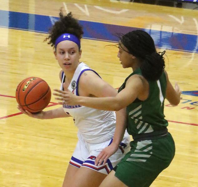UMass Lowell vs Binghamton women's basketball. UML's Kharis Idom (5) and Binghamton's Denai Bowman (1).   (SUN/Julia Malakie)