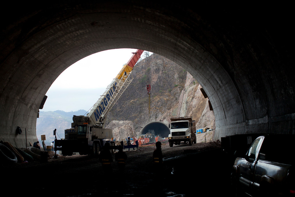 . In this June 11, 2013 photo, workers walk inside one of the many tunnels that comprise the new Durango-Mazatlan highway near Concordia, Mexico.  The Durango-Mazatlan Highway vies to be one of Mexico\'s greatest engineering feats, designed to bring people, cargo and legitimate commerce safely through a mountain range known until now for marijuana, opium poppies and an accident-prone road called the Devil\'s Backbone. (AP Photo/Dario Lopez-Mills)