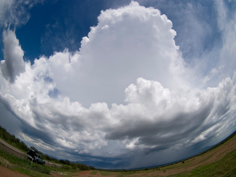 The towering storm cloud of a cumulonimbus, driven upwards by a combination of convection and the hills surrounding Tucson, Arizona. Storms like this are a common sight during monsoon season as pools of moisture get drawn into the normally dry atmosphere. The 8mm fisheye is used to maximise the composition and thereby giving a different perspective from the norm. 