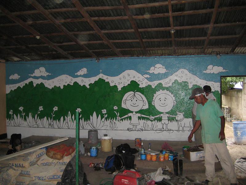 Working on full wall mural.JPG