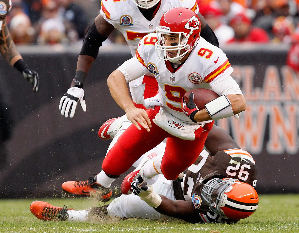. CLEVELAND, OH - DECEMBER 09:  Quarterback Brady Quinn #9 of the Kansas City Chiefs is sacked by defensive lineman Frostee Rucker #92 of the Cleveland Browns at Cleveland Browns Stadium on December 9, 2012 in Cleveland, Ohio.  (Photo by Matt Sullivan/Getty Images)