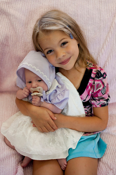 Holding baby A in the outfit SHE wore as a baby.