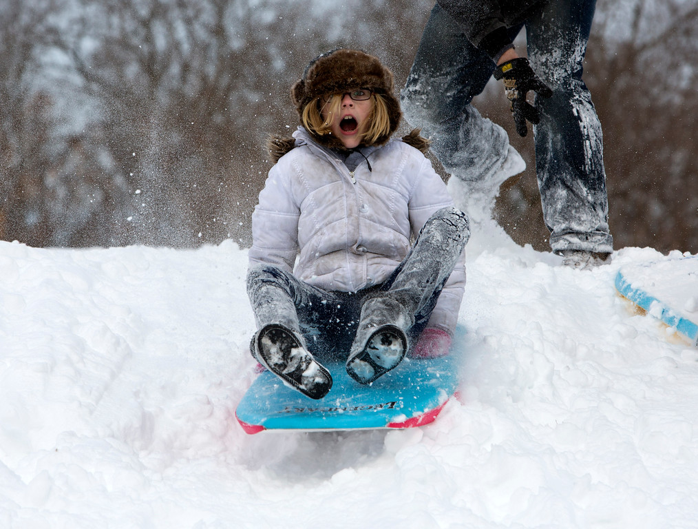 . Mekenzie Bartone, 10, of Norfolk, Va., takes off down the hill on a sled at Northside Community Park in Norfolk on Wednesday, Jan. 29, 2014. The coast of Virginia was blanketed in up to 10 inches of snow Wednesday, with many workers in the heavily populated Hampton Roads region being told to stay home rather than travel to work in dangerous conditions. (AP Photo/The Virginian-Pilot, The\' N. Pham)