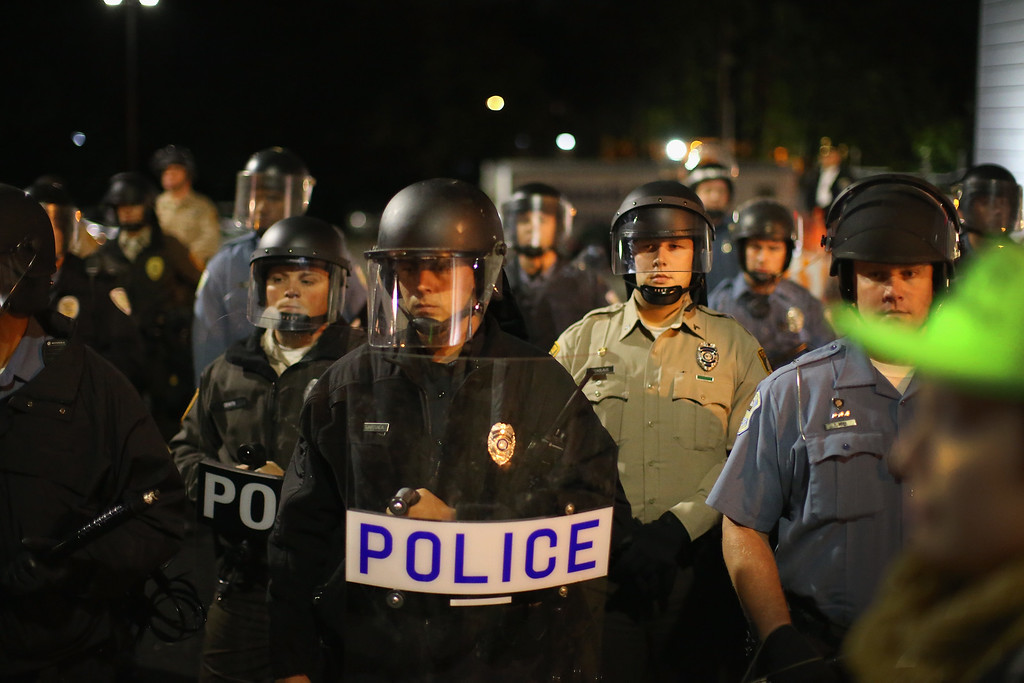 . FERGUSON, MO - OCTOBER 10:  Demonstrators confront police during a protest outside the Ferguson police department on October 10, 2014 in Ferguson, Missouri. Ferguson has been plagued with protests since the death of 18-year-old Michael Brown who was shot and killed by Darren Wilson, a Ferguson police officer on August 9.  (Photo by Scott Olson/Getty Images)