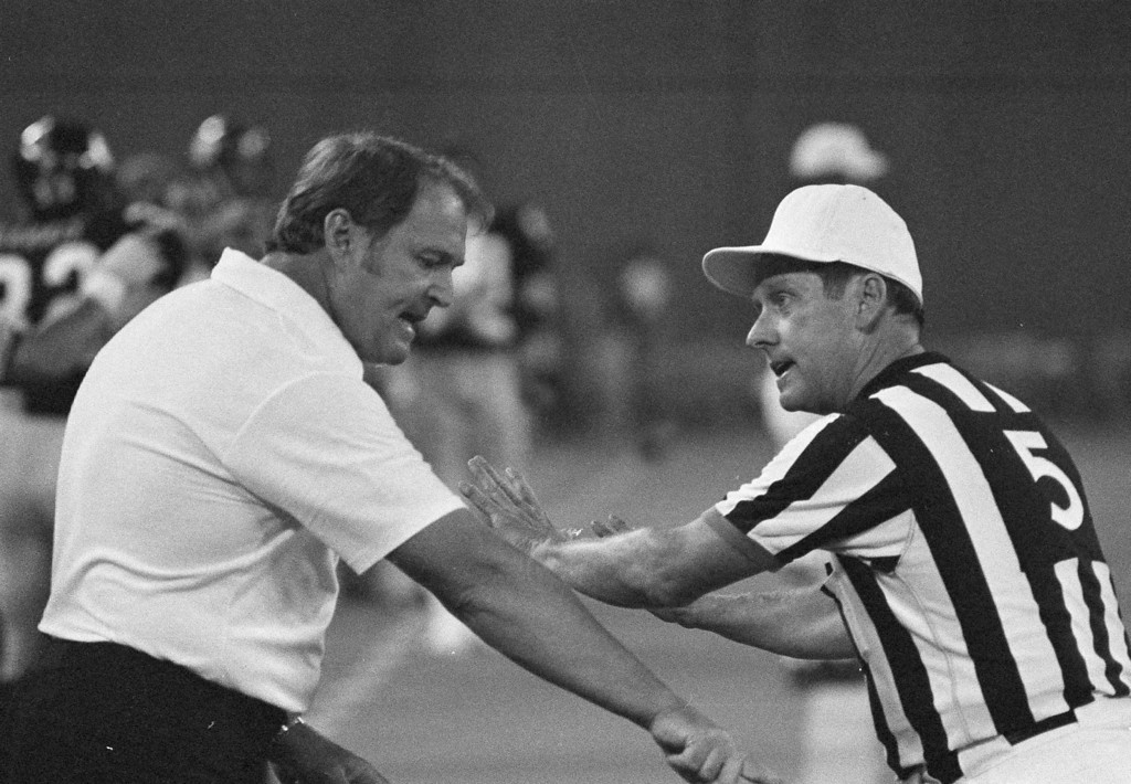. Pittsburgh Steelers head coach Chuck Noll discusses a holding call with NFL official Ray Douglas in the fourth quarter of the Steelers\' game with the Atlanta Falcons Saturday, Aug. 13, 1978 in Pittsburgh. On the disputed play a Steelers touchdown was called back because of a holding call on Bennie Cunningham. Douglas won the argument. Noll\'s team won the game, scoring the winning touchdown on the next play, a touchdown pass to Lynn Swann. (AP Photo/Stewart)
