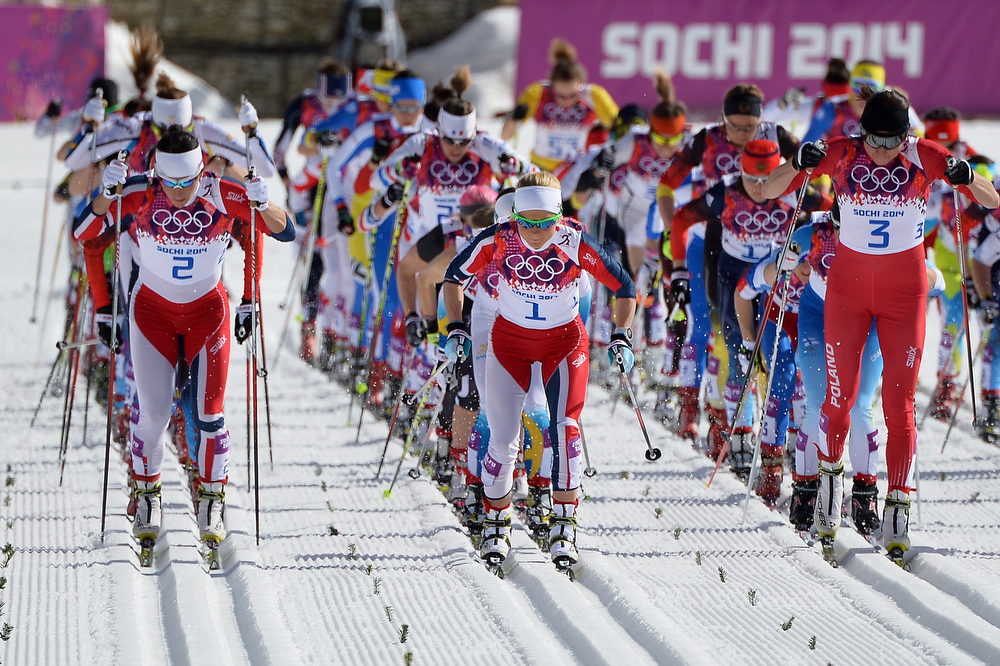 . (1st Row from L) Norway\'s Marit Bjoergen, Norway\'s Therese Johaug and Poland\'s Justyna Kowalczyk take the start of  the Women\'s Cross-Country Skiing 30km Mass Start Free at the Laura Cross-Country Ski and Biathlon Center during the Sochi Winter Olympics on February 22, 2014, in Rosa Khutor, near Sochi.  (ALBERTO PIZZOLI/AFP/Getty Images)