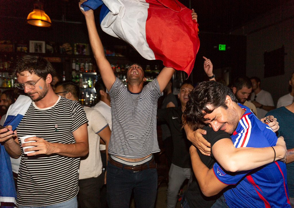 . Soccer fans cheer while watching the final match of the Russia 2018 soccer World Cup between Croatia and France at the Zebulon Cafe Concert in Los Angeles on Sunday, July 15, 2018. (AP Photo/Damian Dovarganes)