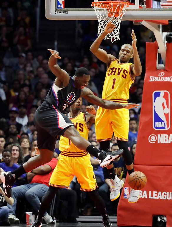 . Los Angeles Clippers\' Brandon Bass, left, loses the ball as he goes up for a basket against Cleveland Cavaliers\' James Jones during the second half of an NBA basketball game Saturday, March 18, 2017, in Los Angeles.  (AP Photo/Jae C. Hong)