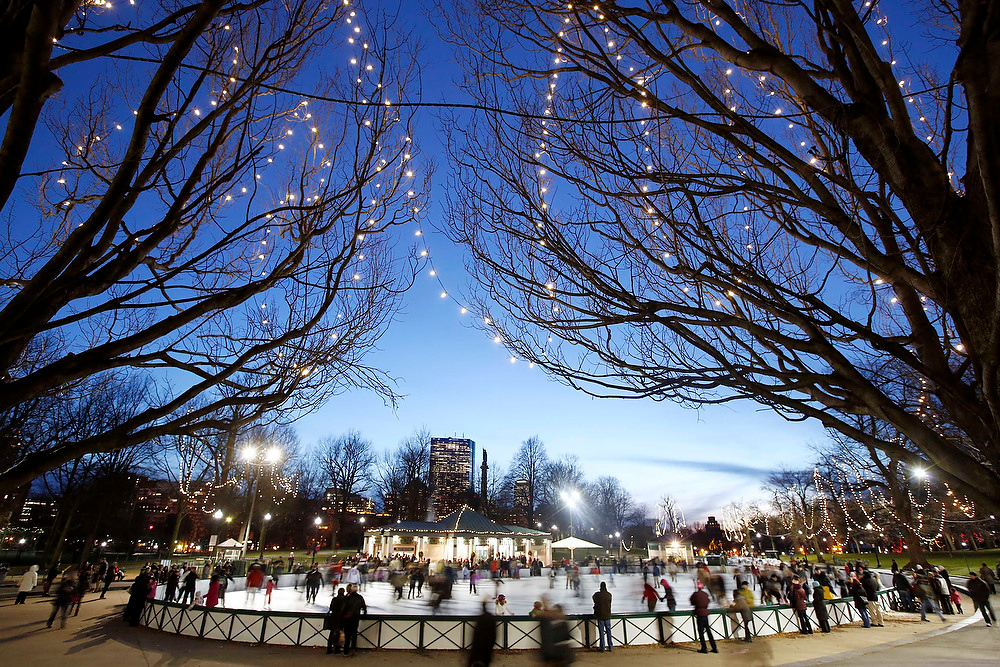 Description of . People skate on an ice rink on the Boston Common in Boston, on Christmas Eve, Monday, Dec. 24, 2012. (AP Photo/Michael Dwyer)