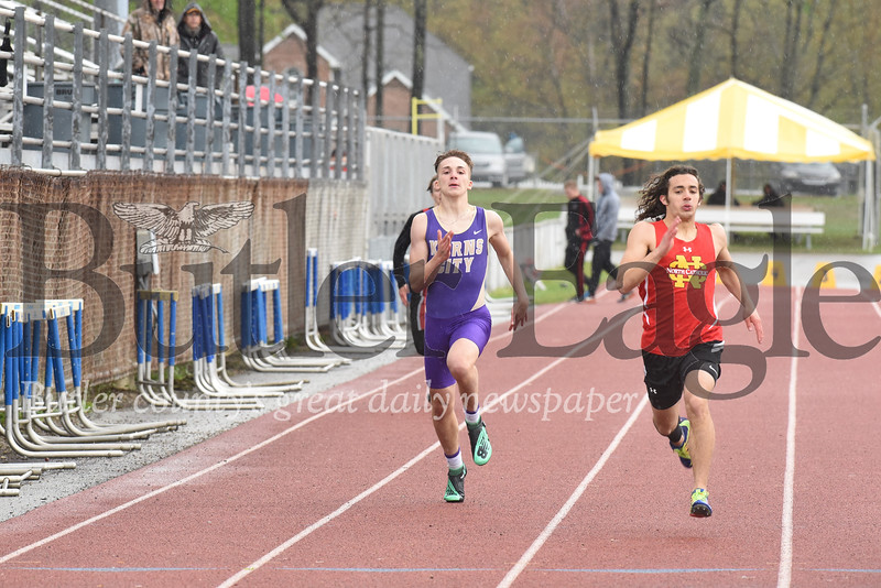 Karns City's Kaden Scherer pushes down the final stretch on his way to third place in the 400 meter.