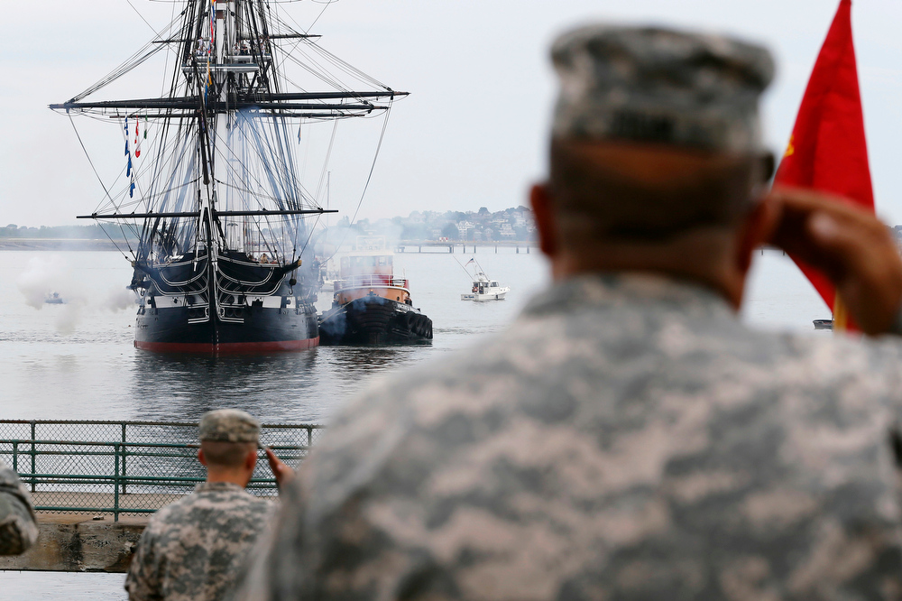 . The USS Constitution fires a 21-gun salute off Castle Island on its annual turn around on Boston Harbor in Boston, Friday, July 4, 2014. (AP Photo/Michael Dwyer)