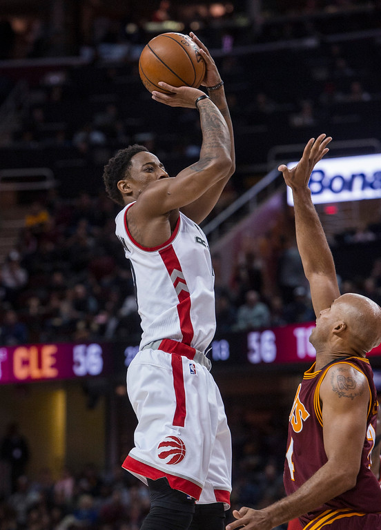 . Toronto Raptors\' DeMar DeRozan (10) shoots over Cleveland Cavaliers\' Richard Jefferson during the first half of an NBA basketball game in Cleveland, Tuesday, Nov. 15, 2016. (AP Photo/Phil Long)