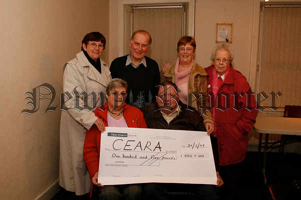 Markethill Horse & Pony Club members present a Cheque for CEARA Special Needs School, Money was raised at a raffle & auction held at the clubs annual supper dance, photo, front Betty Crozier presents the cheque to Paul Hillen (CEARA), rear Chantel Herron, Treavor & Evlyn Mc Caughy and Dorothy Topley, 07W13N55