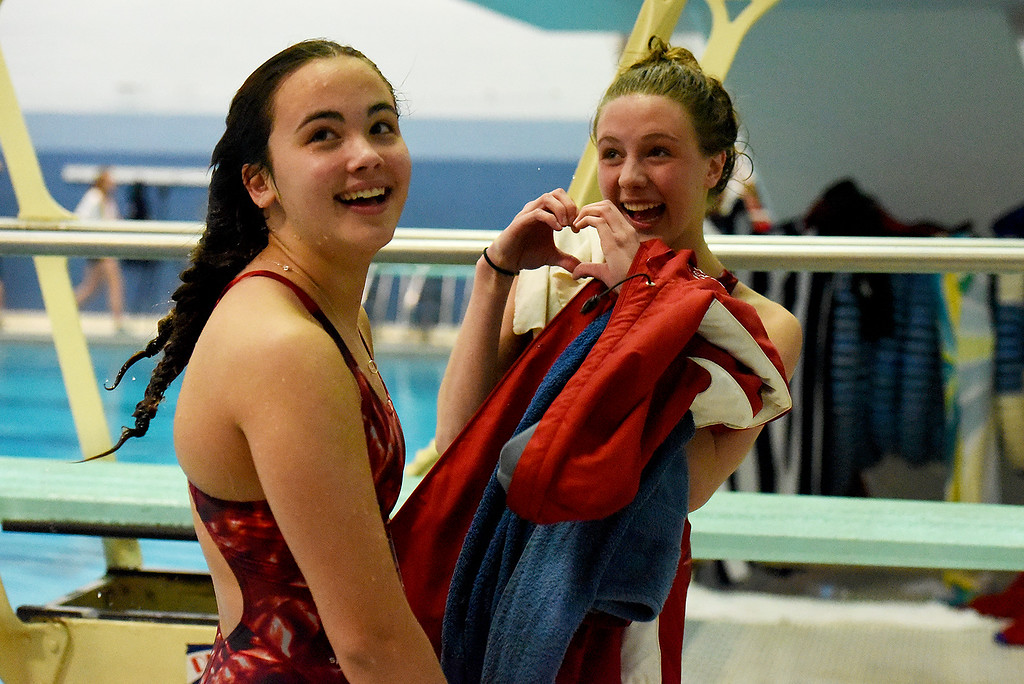 . Regis Jesuit\'s Mckensi Austin, right, sends some love to the crowd of her supports with teammate Anne Kenny at her side during the girls 5A State Swim meet held at Edora Pool and Ice Center on Saturday. (Photo by Kira Horvath/ The Denver Post)