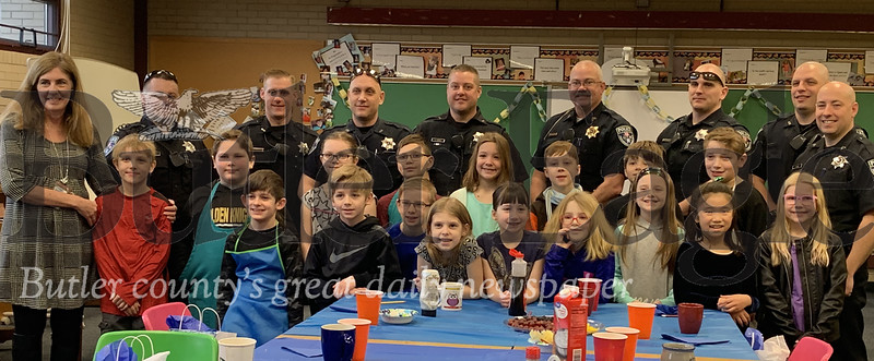 Gifted Education Teacher Rebecca Hester and her third grade students at Rowan Elementary School pose with Cranberry Township police officers after feeding them pancakes, smoothies, coffee and more at their breakfast with cops event Wednesday morning. Photos by Alexandria Mansfield.