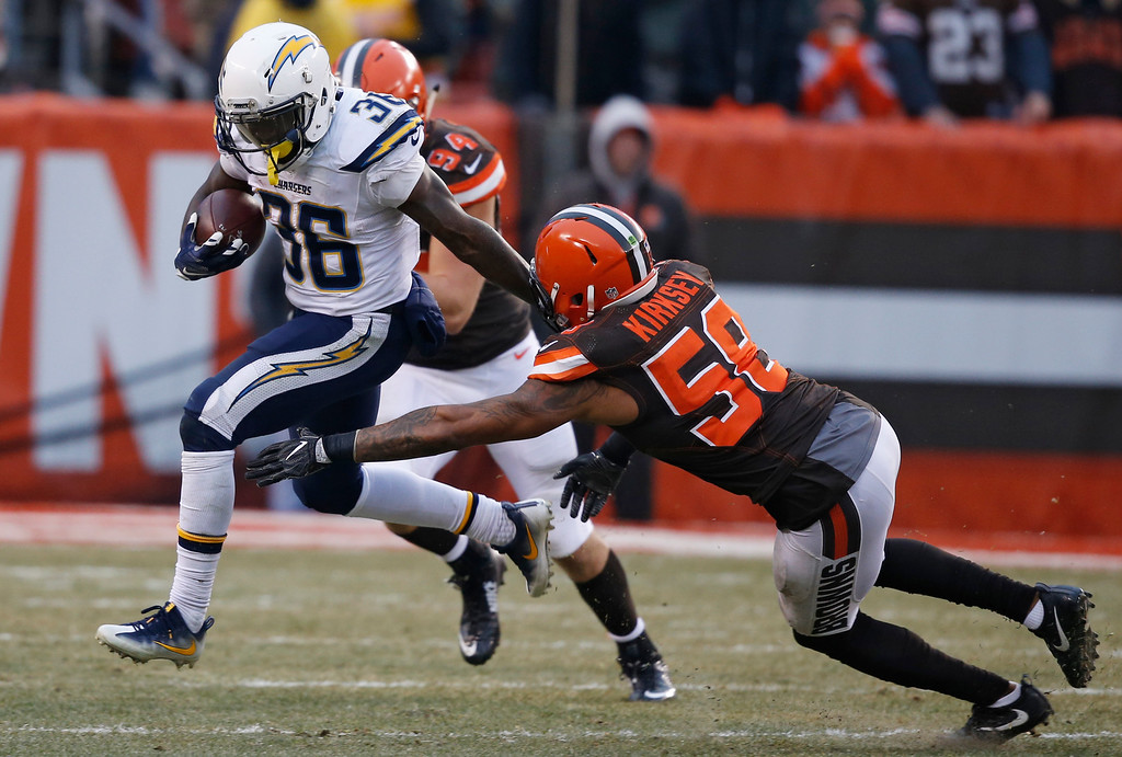 . San Diego Chargers running back Ronnie Hillman (36) is tackled by Cleveland Browns inside linebacker Christian Kirksey (58) in the second half of an NFL football game, Saturday, Dec. 24, 2016, in Cleveland. (AP Photo/Ron Schwane)