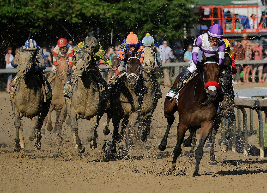 . Mario Guitierrez rides Nyquist to victory during the 142nd running of the Kentucky Derby horse race at Churchill Downs Saturday, May 7, 2016, in Louisville, Ky. (AP Photo/Julio Cortez)