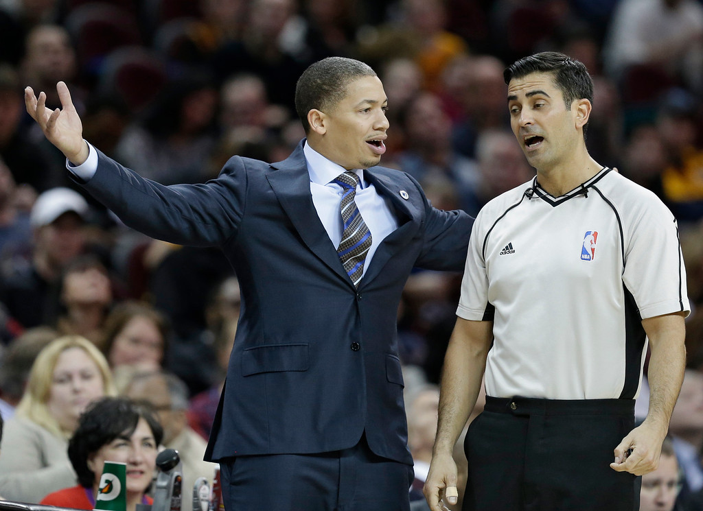 . Cleveland Cavaliers head coach Tyronn Lue argues with official Zach Zarba in the second half of an NBA basketball game against the Charlotte Hornets, Wednesday, Feb. 24, 2016, in Cleveland. The Cavaliers won 114-103. (AP Photo/Tony Dejak)
