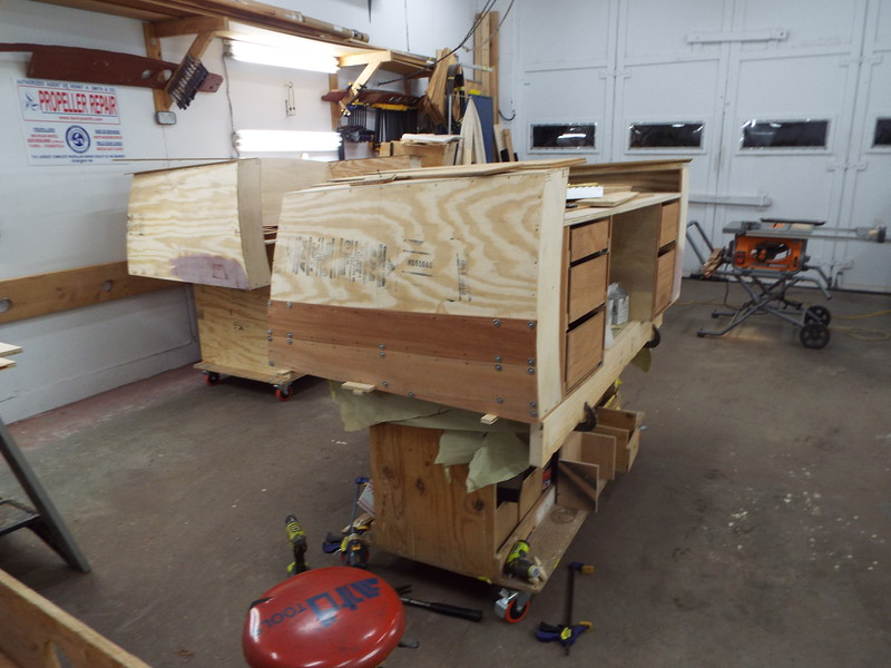 Starting to fit the Mahogany skin to the starboard side of the desk.