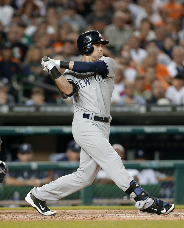 . New York Yankees\' Jacoby Ellsbury bats against the Detroit Tigers in the second inning of a baseball game in Detroit Tuesday, Aug. 26, 2014. (AP Photo/Paul Sancya)