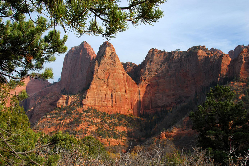 "10/27/07 – On our drive home from St. George we stopped at Kolob Canyon in Zion National Park. We stopped at one point and hiked back in where I took this shot of a ""hanging valley"" (center of image). The rocks slid up hundreds of feet leaving a small valley ""hanging"" up in the sky. When it rains there is a big waterfall that runs for a few minutes and then it dries up. I wish we could have spent more time just exploring."