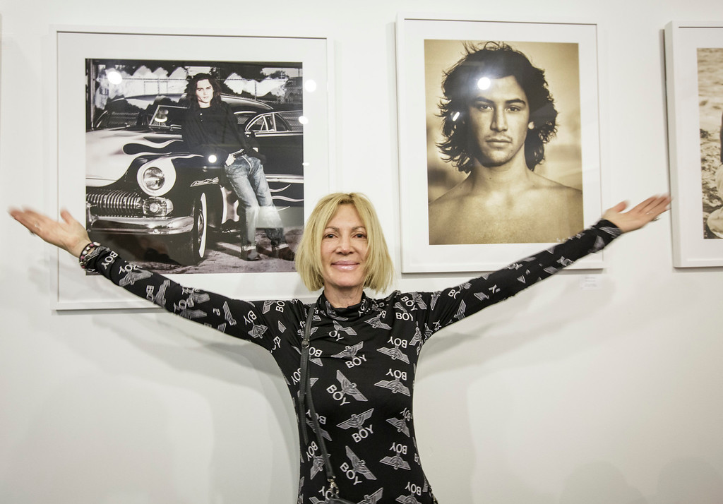 """. Photographer Karen Bystedt poses in front of photos from her series \""""Before they were famous\""""  at the photo la opening party held at The REEF/LA Mart in Los Angeles, CA. January 15, 2015.  Photo by David Sprague/Special to the Daily News"""