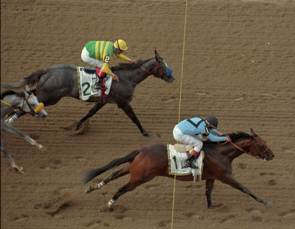 . Jockey Chris McCarron, riding Touch Gold, steals a Triple Crown from Silver Charm, who finished second, leaving Free House, left, with a third place in the 129th running of the Belmont Stakes Saturday, June 7, 1997, at Belmont Race Track in Elmont, N.Y. (AP Photo/Bill Kostroun)