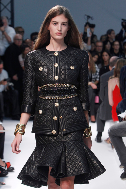 . A model wears a creation for Balmain ready-to-wear Spring/Summer 2014 fashion collection, presented in Paris, Thursday, Sept.26, 2013. (AP Photo/Thibault Camus)