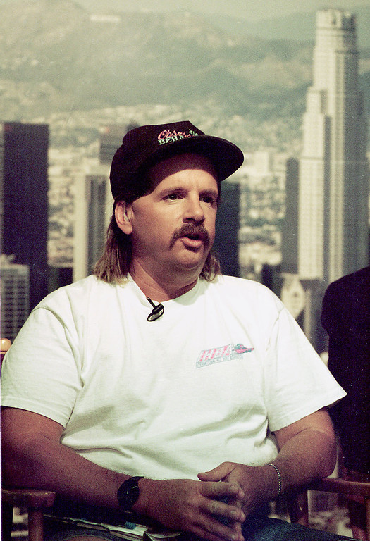 . Truck driver Reginald Denny speaks during a television interview in this file photo taken July 27, 1993 in Los Angeles.  Denny was delivering sand to a cement plant when he unwittingly drove into the epicenter of the Los Angeles riots that had begun a few hours before. Television viewers were shocked by helicopter footage showing several black men pulling the white Denny from the cab, then kicking and beating him. He was unable to talk when he woke up days after the attack, but he soon became aware that he had become the counterpoint to the Rodney King beating. (AP Photo)