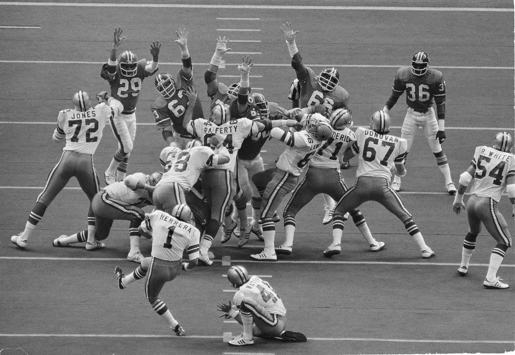 . Dallas kicker Efren Herrera (1) kicks a field goal over the outstretched arms of the Denver Broncos defenders in the first quarter in Super Bowl XII in New Orleans. (AP Photo)