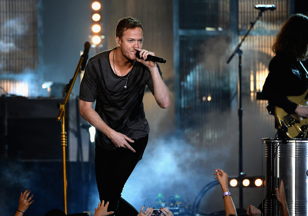 . Recording artist Dan Reynolds of Imagine Dragons performs onstage during the 2014 Billboard Music Awards at the MGM Grand Garden Arena on May 18, 2014 in Las Vegas, Nevada.  (Photo by Ethan Miller/Getty Images)