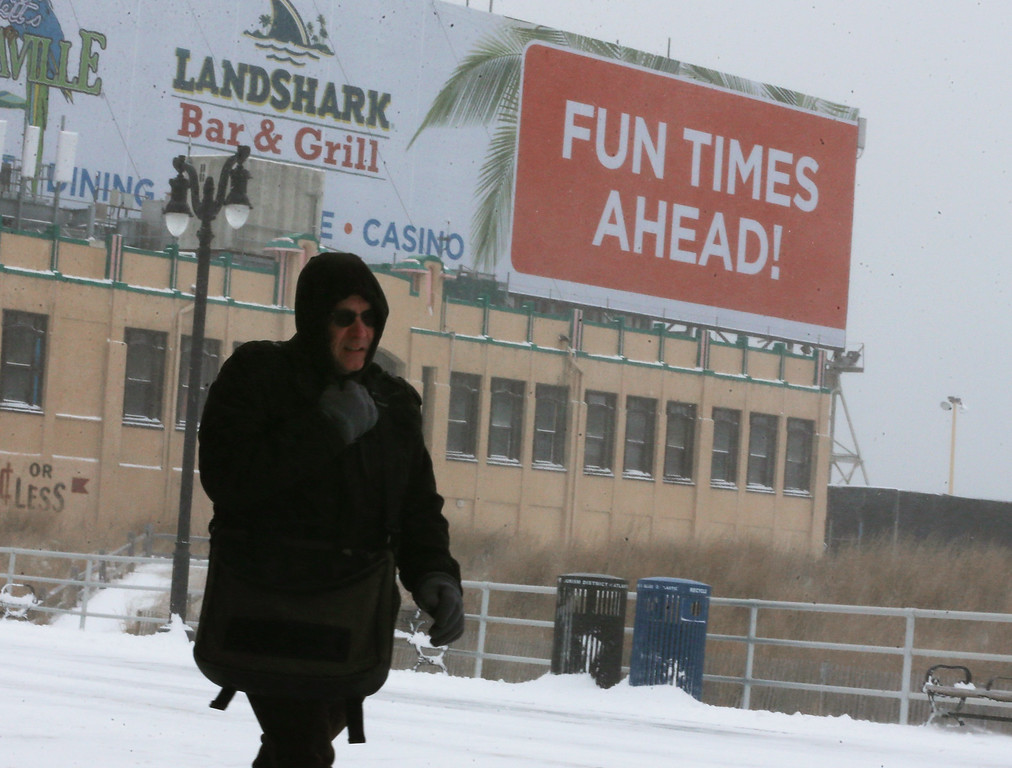 . A man walks in the cold weather along the snow covered Atlantic City boardwalk on January 27, 2015 in Atlantic City, New Jersey. Much of the Northeast was hit with a major winter storm that is expected to bring blizzard conditions and 10 to 24 inches of snow in some areas.  (Photo by Mark Wilson/Getty Images)
