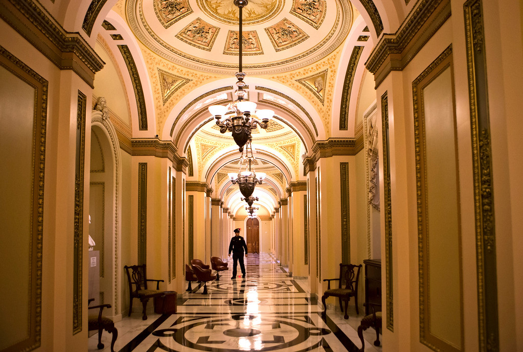 . The corridor that leads to the floor of the House of Representatives is empty late Monday with no voting expected on a the fiscal cliff, in Washington, Monday, Dec. 31, 2012. House and Senate leaders are rushing to assemble a last-ditch agreement to head off the automatic tax hikes and spending cuts set to take effect Jan. 1. (AP Photo/J. Scott Applewhite)