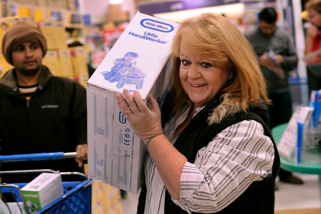 . Desi Maughan found an item she wanted to give to one of her grandchildren during a shopping spree at the Toys R Us store on County Line Road in Arapahoe County Thursday night, November 28, 2013. Many metro area stores got a jump on Black Friday by opening Thanksgiving night. Photo By Karl Gehring/The Denver Post