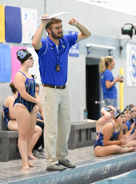 091416  Wesley Bunnell | Staff  Southington Girls Swimming competed against visiting E.O. Smith High School on Wednesday afternoon at the Southington YMCA.  Head Coach Evan Tuttle gives instructions to his swimmers.