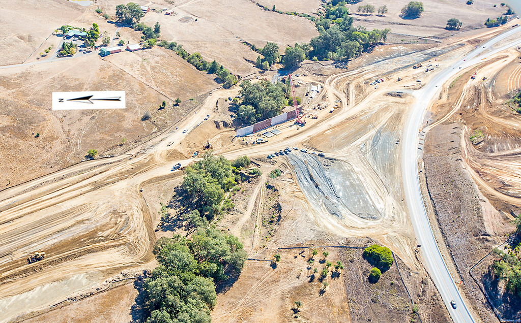 . The southern interchange showing the large retaining wall at Haehl Creek. Willits bypass construction overflight Sept. 5; Pilot Mike Smith; photographer Steve Eberhard/TWN
