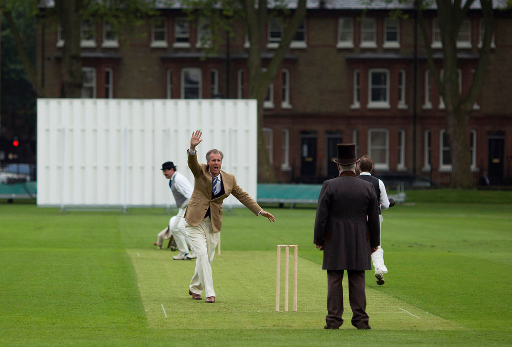 . A bowler makes a wicket appeal to umpire British author and former politician Jeffrey Archer, center right, during a Victorian-era costume themed cricket match on a wicket in Vincent Square, central London, Wednesday, May 29, 2013.  The two-over-a-side Victorian match was held Wednesday to mark the launch of the 150th anniversary edition of the Wisden Cricketers\' Almanac.  (AP Photo/Matt Dunham)