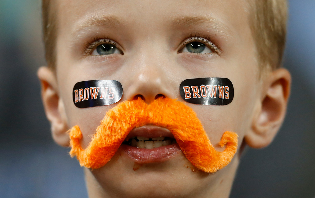 . Cleveland Browns fan Dylon Hershberger, of Dalton, Ohio watches against the Detroit Lions in the first half of a preseason NFL football game at Ford Field in Detroit, Saturday, Aug. 9, 2014.  (AP Photo/Rick Osentoski)