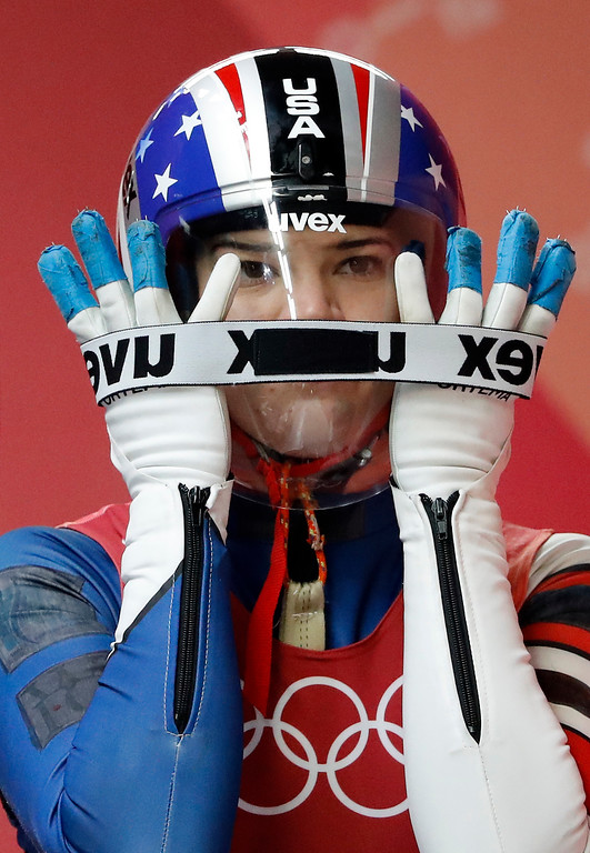 . Summer Britcher of the United States starts her first run during the women\'s luge competition at the 2018 Winter Olympics in Pyeongchang, South Korea, Monday, Feb. 12, 2018. (AP Photo/Andy Wong)