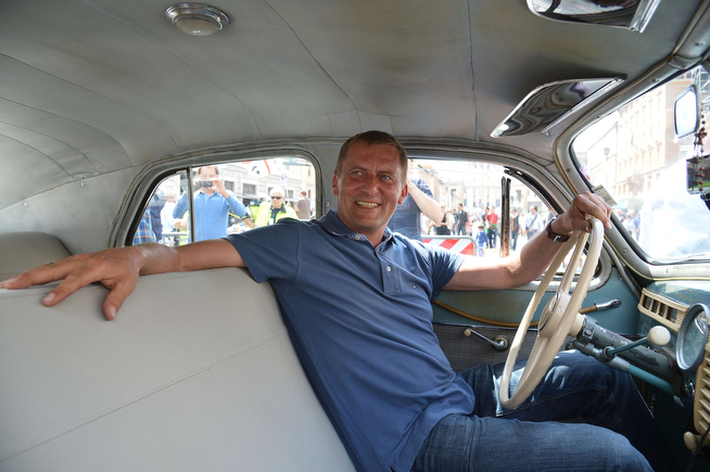 """. German Marek Schramm poses inside his car, the former car of late Pope Jean Paul II, he drove from Germany to honour his canonisation on April 26, 2014 in Rome. Marek Schramm, an admirer of the late pope, got behind the wheel of the spruced-up FSO Warszawa, sporting a \""""JP2\"""" license plate, to make the long trip from Berlin to Italy. Popes John Paul II and John XXIII will join the roster of saints at a historic Vatican ceremony on Sunday seen as an attempt to unite conservatives and reformists, with some 800,000 pilgrims expected in Rome. The double canonisation of two of modern-day Catholicism\'s most influential figures will be presided over by Pope Francis and may be attended by his elderly predecessor Benedict XVI, bringing two living pontiffs together to celebrate two deceased predecessors.  (ALBERTO PIZZOLI/AFP/Getty Images)"""