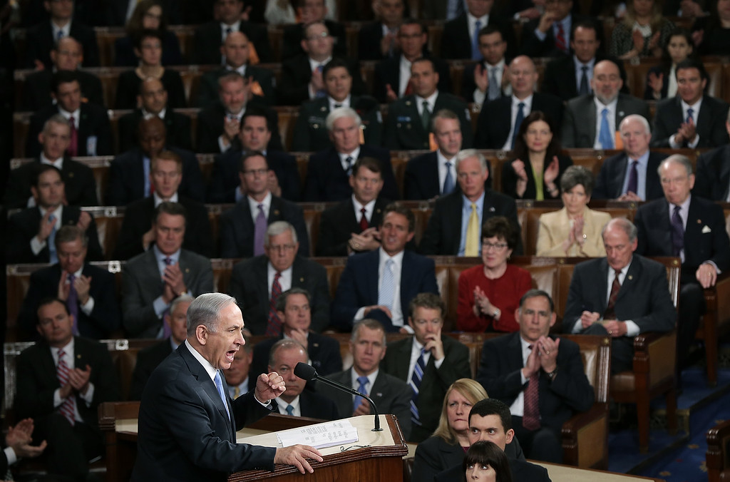 """. Israeli Prime Minister Benjamin Netanyahu addresses a joint meeting of the United States Congress in the House chamber at the U.S. Capitol March 3, 2015 in Washington, DC. During his speech, Netanyahu said, \""""Today the Jewish people face yet another attempt by another Persian potentate to destroy us.\""""  (Photo by Win McNamee/Getty Images)"""