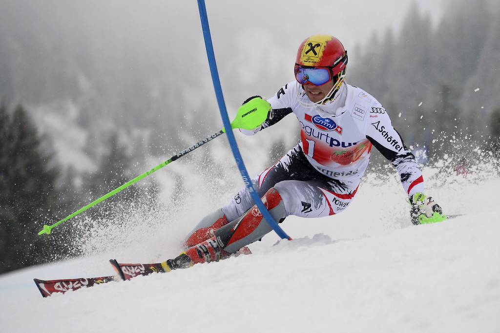 . Austria\'s Marcel Hirscher competes during the FIS Men\'s alpine skiing World Cup Slalom finals,  on March 16, 2014,  in Lenzerheide. AFP PHOTO / FABRICE COFFRINI