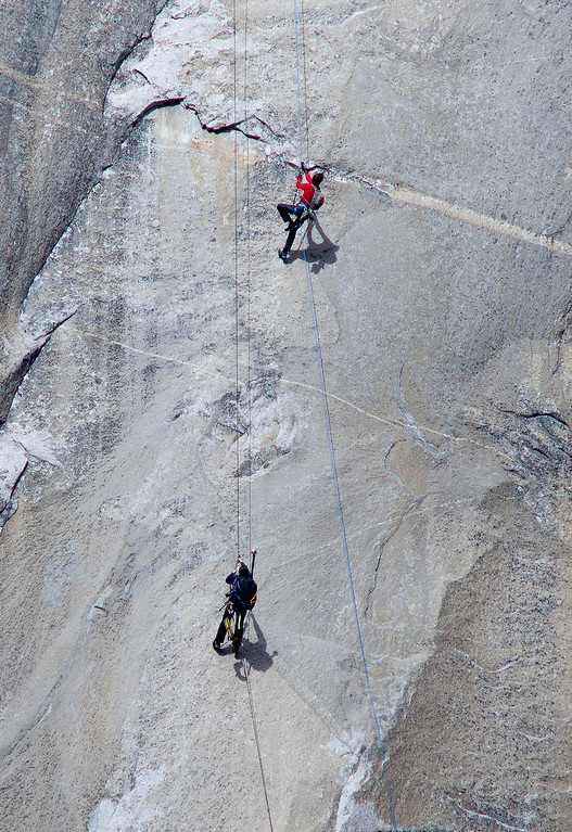 . In this Jan. 12, 2015 photo provided by Tom Evans, Kevin Jorgeson, top, and a photographer ascend ropes to where Jorgeson will climb on what has been called the hardest rock climb in the world: a free climb of El Capitan, the largest monolith of granite in the world, a half-mile section of exposed granite in California\'s Yosemite National Park. El Capitan rises more than 3,000 feet above the Yosemite Valley floor. The first climber reached its summit in 1958, and there are roughly 100 routes up to the top. (AP Photo/Tom Evans, elcapreport)