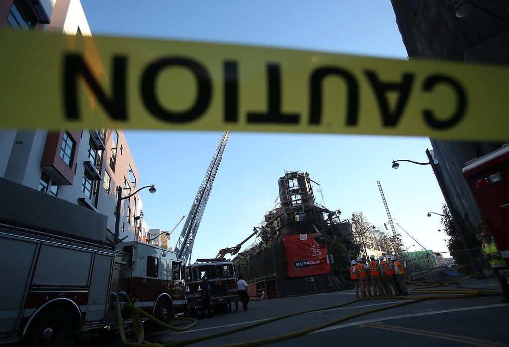 . Crews begin demolition of an apartment complex on Fourth Street in the Mission Bay neighborhood of San Francisco, Calif., on Wednesday, March 12, 2014. Firefighters remained on scene as the ruins of the $227 million project were still smoldering after being destroyed by a massive 5-alarm blaze on Tuesday. (Jane Tyska/Bay Area News Group)