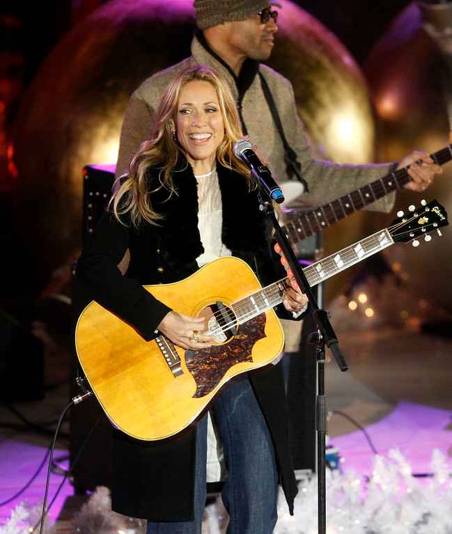 . Singer Sheryl Crow performs during the 78th annual Rockefeller Center Christmas tree lighting ceremony Tuesday, Nov. 30, 2010, in New York. (AP Photo/Jason DeCrow)