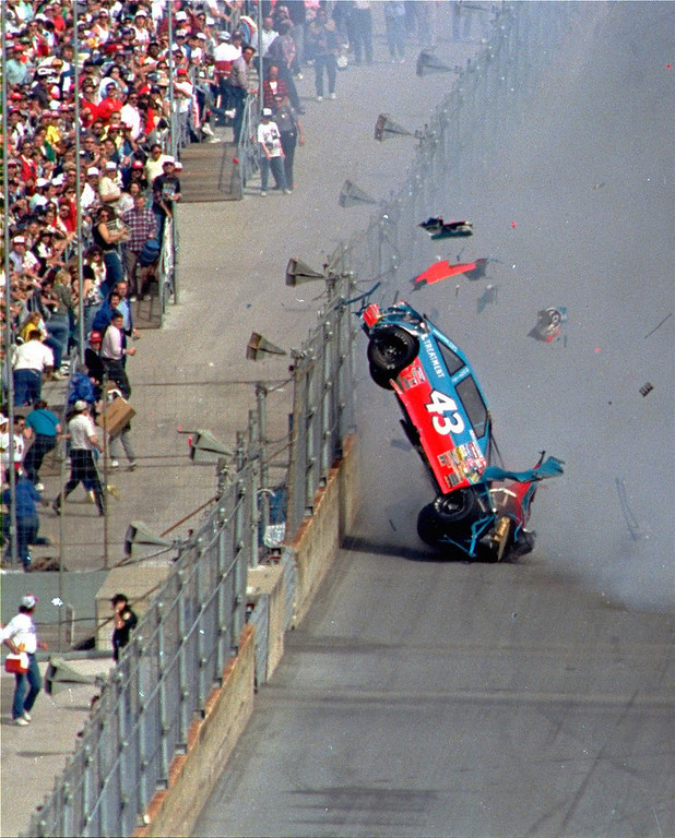 . Richard Petty\'s car comes apart after going airborne and impacting the wall and fence off turn four at Daytona International Speedway.  Petty reportedly was in good condition at a local hospital with possibly a broken ankle from the mishap which involved Petty\'s Pontiac car flipping seven times during Sunday\'s running of the Daytona 500 auto race, Feb. 14, 1988.  (AP Photo/Pryor)