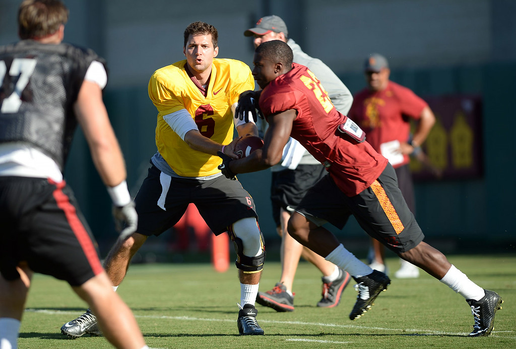 . USC quarterback Cody Kessler hands off the ball during practice August 27, 2014 on USC\'s Howard Jones Field.(Andy Holzman/Daily News Staff Photographer)