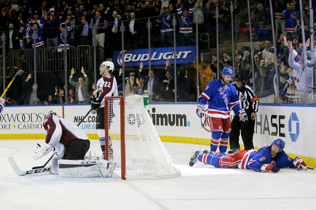 . New York Rangers\' Mats Zuccarello (36) and Dan Girardi (5) celebrate after Girardi scored a goal as Colorado Avalanche goalie Semyon Varlamov (1), of Russia, reacts, during the second period of an NHL hockey game Thursday, Nov. 13, 2014. (AP Photo/Frank Franklin II)