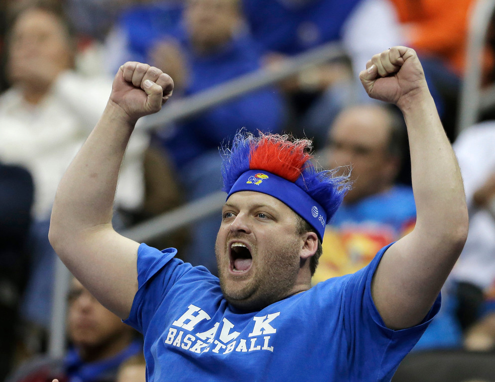 . A Kansas fan cheers during the first half of a second-round game between Kansas and Western Kentucky in the NCAA men\'s college basketball tournament Friday, March 22, 2013, in Kansas City, Mo. (AP Photo/Charlie Riedel)